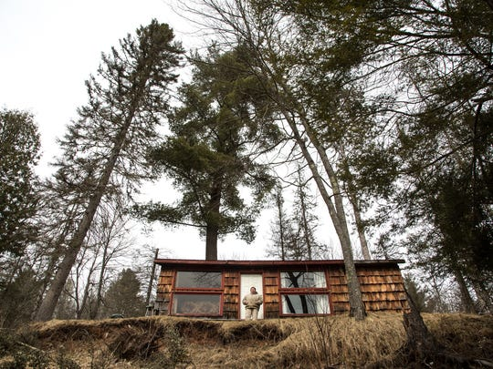 "Alvin Hiitola, 59, of Trout Creek stands outside his cabin on Sunday March 19, 2017. ""This will be 30 years we've had this camp, and to see it gone after all the work we've put into it, after all the good times we've had down here, it's just sad,"" Hiitola said. ""And, I believe, for absolutely no reason."""