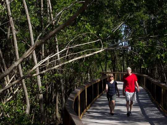 Jim and Pat Sinclair, seasonal residents from Minnesota, walk along the Gordon River Greenway in Naples in November 2014.