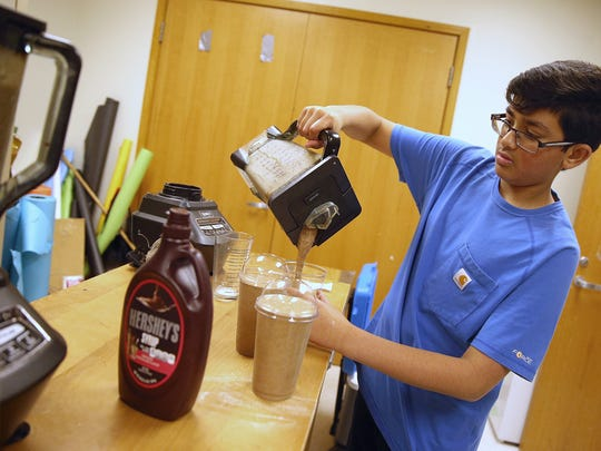 Freshman Jodh Pullela, 14, makes frappuccinos at the Carmel Cafe and Market run by DECA students at Carmel High School, Thursday, May 4, 2017. Students have been self-running the coffee shop and spirit-wear business for three years, based on a plan designed for class by two Carmel high alumni.