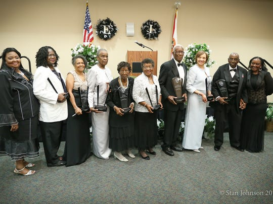 """Former Gadsden County School Superintendent Robert Bryant stands among honorees in 2017 to accept a """"Pacesetter in Education"""" Award from the Gadsden County Democratic Women's Club."""