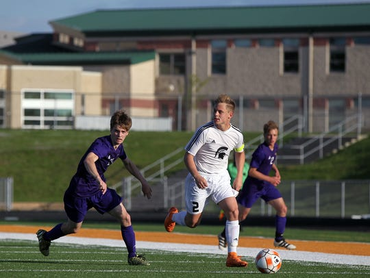 Solon's Benjamin Carr takes the ball down field during