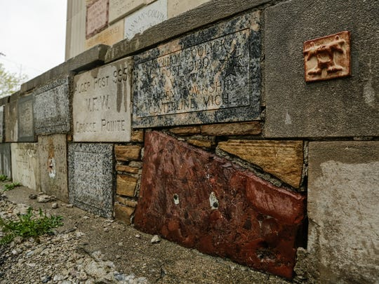 Plaques are seen missing in the 40-foot-tall deteriorating Michigan War Veterans Memorial near the now-abandoned State Fairgrounds in Detroit on Friday May 5, 2017.