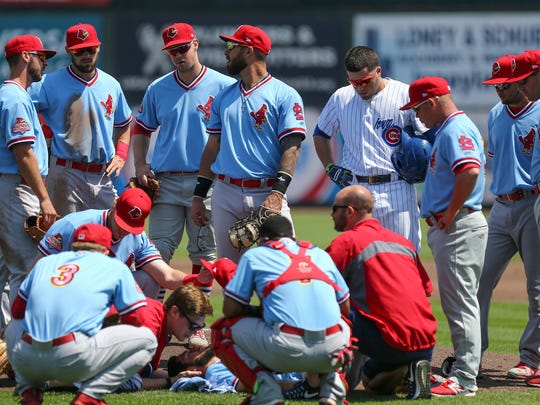 Trainers tend to Memphis Redbirds starting pitcher Daniel Poncedeleon, who was struck in the head by a ball on Tuesday, May 9, 2017, during a game against the Iowa Cubs in Des Moines, Iowa.