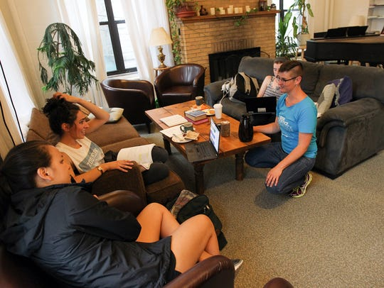 Rev. Anna Blaedel chats with studying students at the