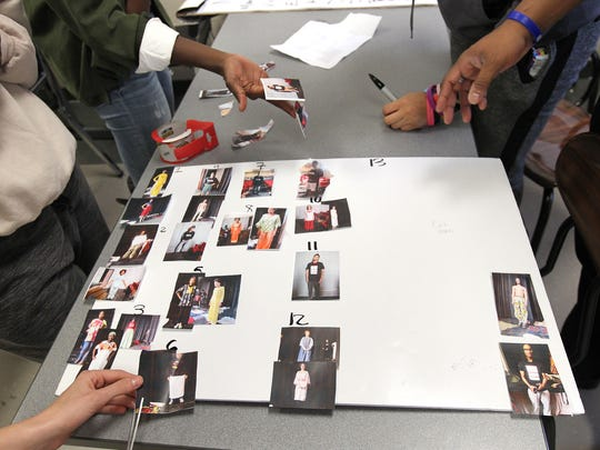 City High students put together a mood board for their fashion show during class on Thursday, May 11, 2017.