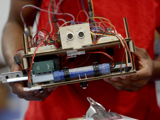 Nathaniel Lee, 18, holds his robot after the competition during the Robofest Michigan Championship on Saturday, May 13, 2017 at Lawrence Tech University in Southfield.