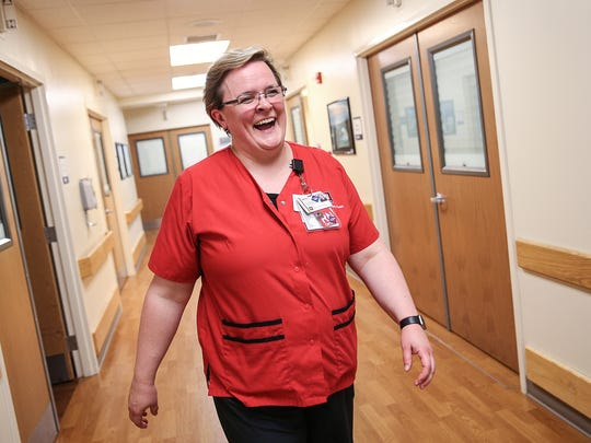 Nicole Meyer laughs with a co-worker during her shift in the trauma center at IU Health Methodist Hospital, Thursday, May 11, 2017. A year ago, Meyer made the transition from Monroe County coroner to trauma nurse. Meyer says the jobs are alike in that you never know what to expect on a day-to-day basis, but at the end of the day, it's about caring for people and families.