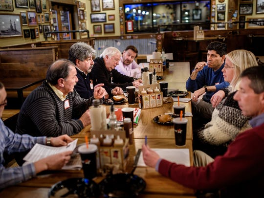 York Daily Record/Sunday News editors, at right, from rear, Scott Blanchard, Susan Martin and Scott Fisher meet with readers, from left, Derek Merson, Gary Markle, Joe Ambrosio, Jon Johnston and Ken Iman, for a discussion on perceived bias and local coverage in newspapers at Mission BBQ in York, Pa., on Feb. 13, 2016.
