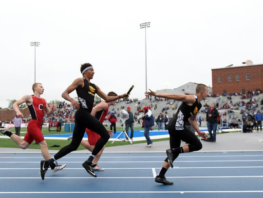 Lone Tree's Niko Gosnell hands the baton to Avery Knock