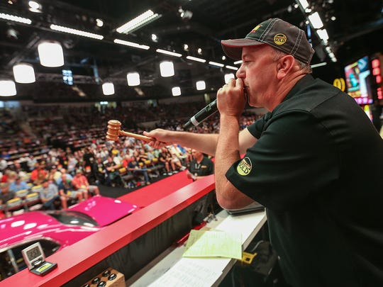 Auctioneer Russ Conklin takes bids on collector cars at the 30th annual Mecum Auctions, Indiana State Fairgrounds, Indianapolis, Friday, May 19, 2017.