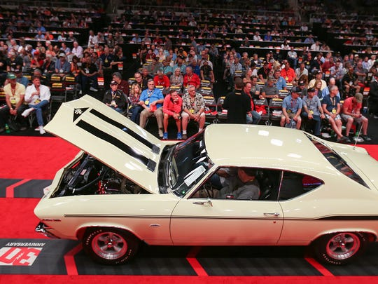 A 1969 Chevrolet Yenko Chevelle is auctioned off at the 30th annual Mecum Auctions, Indiana State Fairgrounds, Indianapolis, Friday, May 19, 2017. Bids sat at $210,000 for the car Friday afternoon.