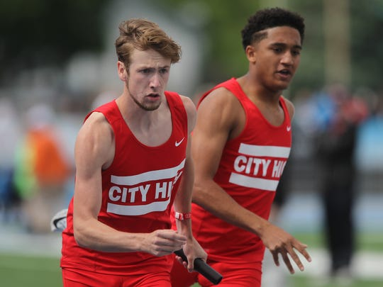 City High's Jack Roggeveen takes the baton from Zach Jones during the 4A boys 4x400 meter relay at the 2017 State Track and Field Championship at Drake Stadium in Des Moines on Saturday, May 20, 2017.
