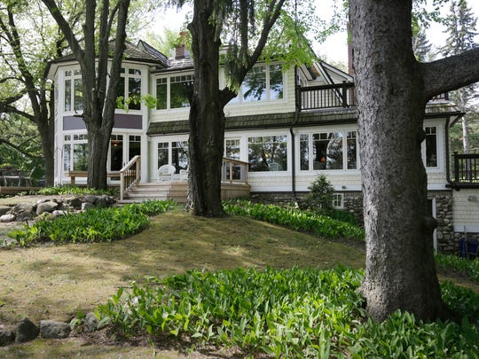 This 1928 Tudor is on 2 acres on Lake Angelus with