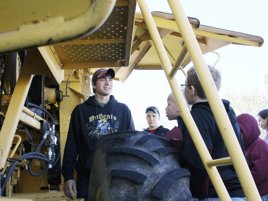 Older FFA students often lead safety presentations to younger school children to highlight the dangers associated with farm machinery.