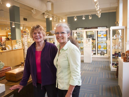 Iowa Artisans Gallery co-owners Christiane Knorr, left, and Astrid Bennett pose for a photo on Wednesday, Sept. 24, 2014.   David Scrivner / Iowa City Press-Citizen