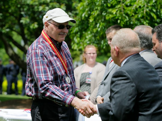 Army veteran Paul Vico of Morris Plains recieves the Distinguished Service Award medal from the Morris County freeholders during the Morris County's Memorial Day ceremony for veterans on the lawn in front of the Morris County Courthouse in Morristown, NJ Wednesday May 24, 2017.