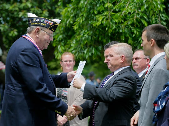 Air Force veteran Kenneth Gorman of Mount Hope recieves the Distinguished Service Award medal from the Morris County freeholders during the Morris County's Memorial Day ceremony for veterans on the lawn in front of the Morris County Courthouse in Morristown, NJ Wednesday May 24, 2017.