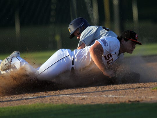 Solon's Tyler Linderbaum misses a tag on Regina's Masen
