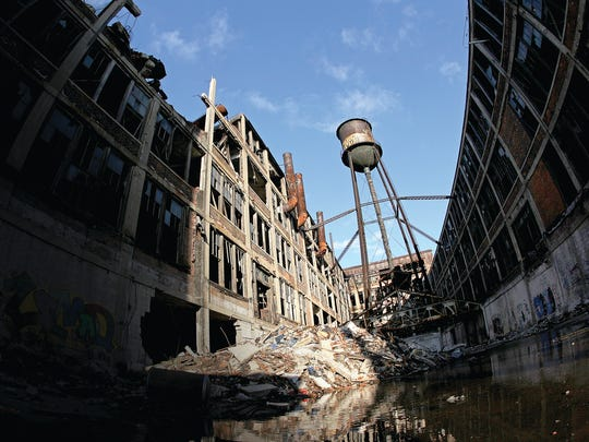 The Packard Plant's south water tower stands above the crumbling complex in November 2010, only a few months before it, too, was brought down by scrappers.