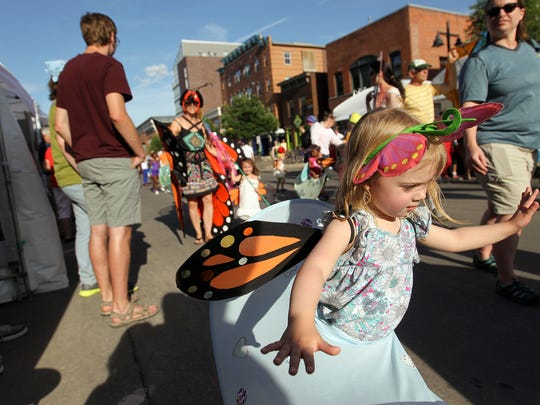 Alexandra Burns, 3, runs down Iowa Avenue at the Iowa Arts Festival on Friday, June 3, 2016.