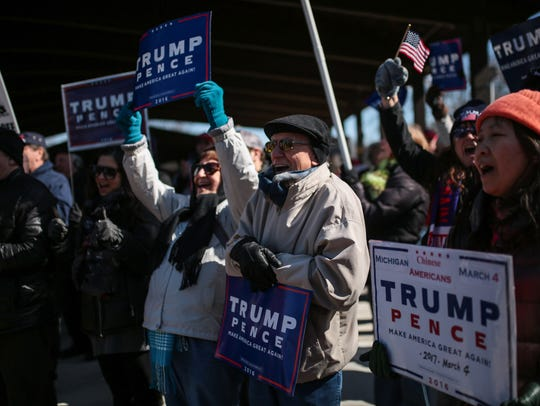 "Trump supporters shout ""USA,"" during a rally on March"