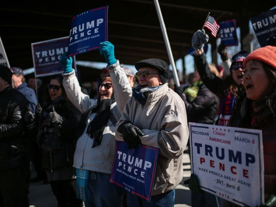 "Trump supporters shout ""USA,"" during a rally on March 4, 2017, in Sterling Heights. An EPIC-MRA poll of likely Michigan voters last week shows 35% gave Trump a positive job rating, down from 39% in February."