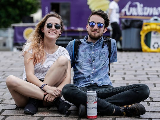 Marissa Mann, left, and Roland Deblasio, both of Cincinnati, Ohio, pose for a photo on the third day of Movement Music Festival at Hart Plaza, Monday, May 29, 2017 in Detroit.