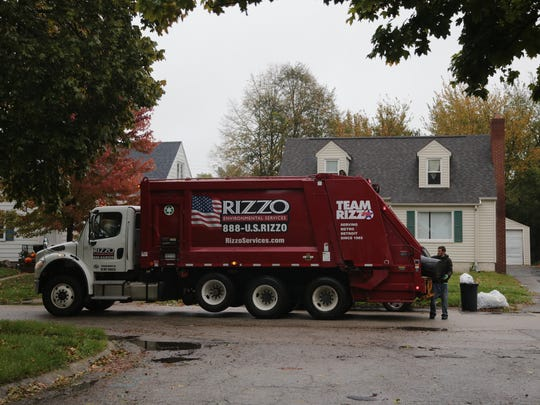 Rizzo Environmental Services workers pick up trash on Hastings St. in Flint on Thursday October 27, 2016.