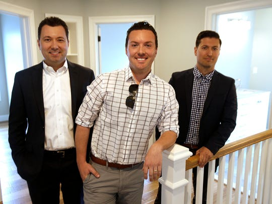 Christopher Lombardi (left) is shown with his brothers Matthew (center) and Robert in the home they renovated at 211 River Ave in Point Pleasant Beach Tuesday, May 30, 2017.