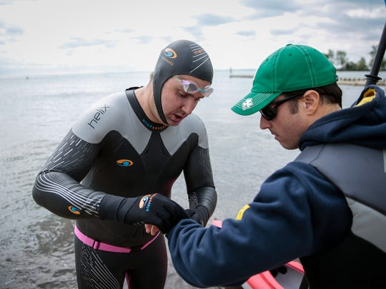 John Fodell of Grosse Pointe, center, sets up a swim