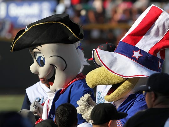 Corpus Christyi Hooks' mascots, Rusty (L) and Sammy were patriotically outfitted for the game between Springfield and Corpous Christi at Whataburger Field in Corpus Christi,  Friday,  July 4, 2014.