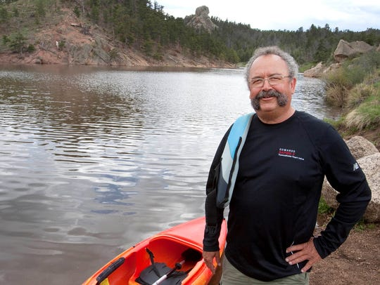 Stan Kepley gets ready to kayak near his home at Curt