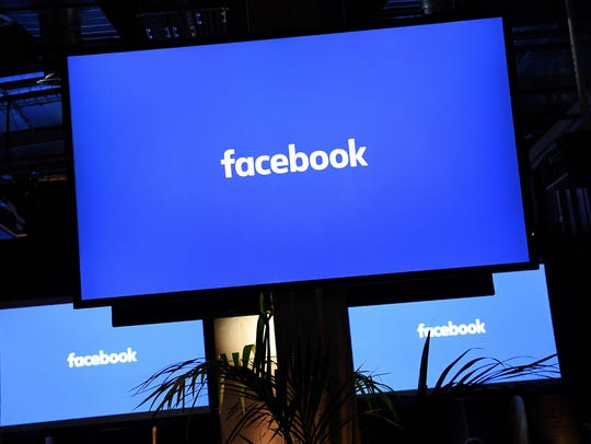 AFP_H09NA.jpg A Facebook logo is pictured on a screen