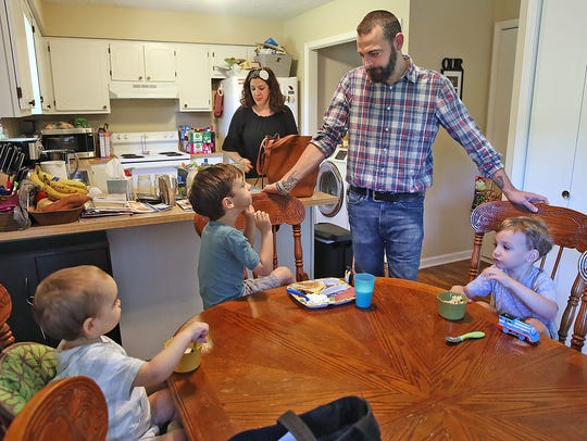 Adam Hayden hangs with his family in their Greenwood