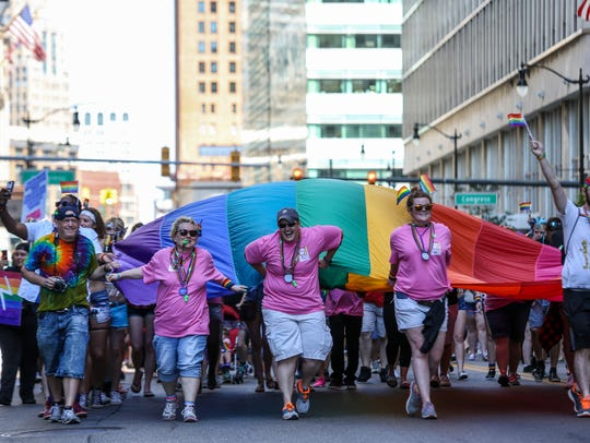 A large LGBTQ flag is presented at the end of the Motor