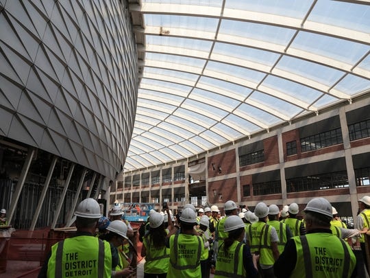Media members are shown around during a construction tour of the Little Caesars Arena in downtown Detroit on June 12, 2017.