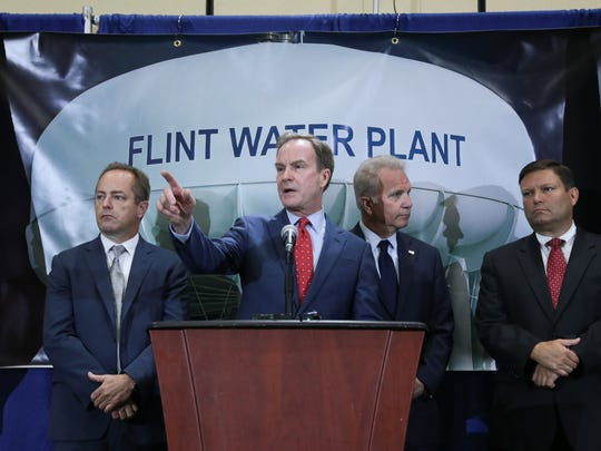 Attorney General Bill Schuette takes questions after announcing new charges against two high-ranking state health officials in the Flint drinking water crisis on Wednesday June 14, 2017.