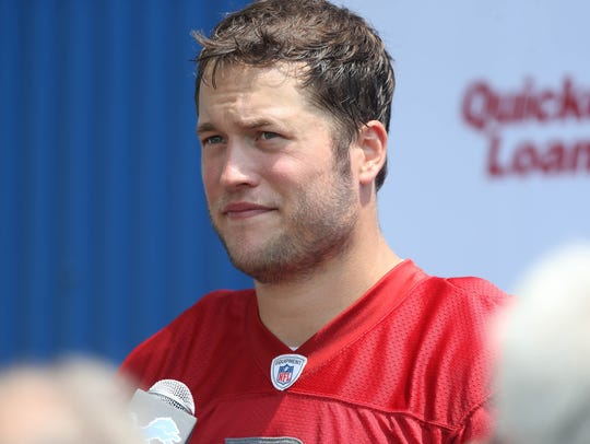 Detroit Lions quarterback Matthew Stafford talks with