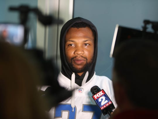 Lions safety Glover Quin talks with reporters after