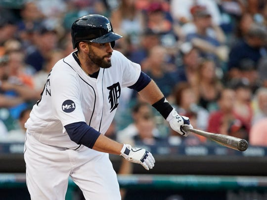 Tigers rightfielder J.D. Martinez (28) hits a single in the fourth inning of the Tigers' 13-4 win over the Rays Friday at Comerica Park.