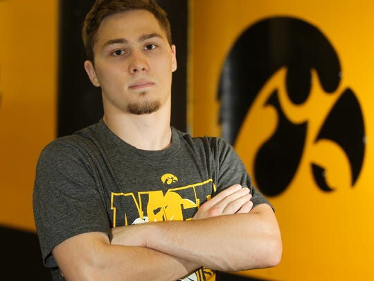 Incoming freshman Spencer Lee poses for a photo in the wrestling room at Carver-Hawkeye Arena on Thursday, June 15, 2017.