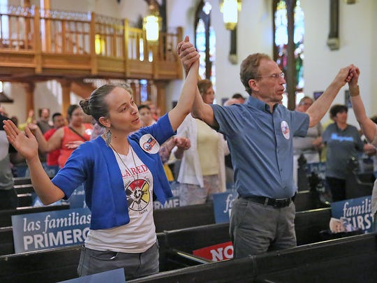 Sister Tracey Horan, left, sings in praise with others at Christ Cathedral, during a vigil and march from the City Market to Christ Cathedral on Monument Circle, calling on city and county law enforcement to stop supporting unlawful detentions of undocumented immigrants by Immigration and Customs Enforcement (ICE), Thursday, June 15, 2017.