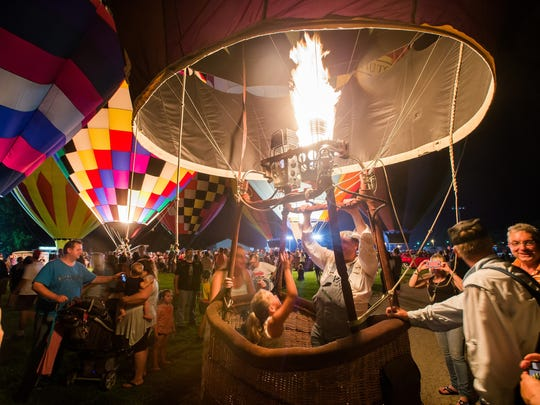 The Hot Air Balloon Glow offers onlookers the opportunity to explore the hot-air balloons up close, chat with pilots and get their photos taken in baskets