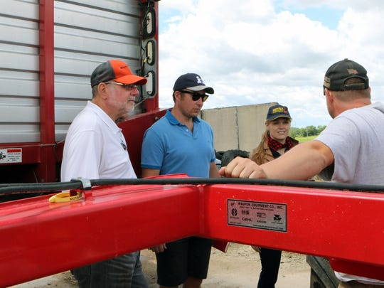 Troy Schlender (right), a third generation farmer in Jefferson County, talks about the machinery he uses on his farm, Never Rest Dairy, during a visit from 11 Nuffield scholars on June 19. It's the first time the scholar group has stopped in Wisconsin as part of its world-wide tour.