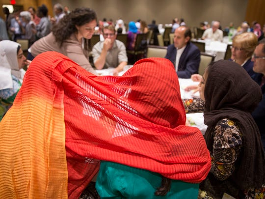Muslims and Jews eat Middle Eastern food, during an interfaith service observing Iftar, an especially holy day during Ramadan, Wednesday, June 21, 2017.