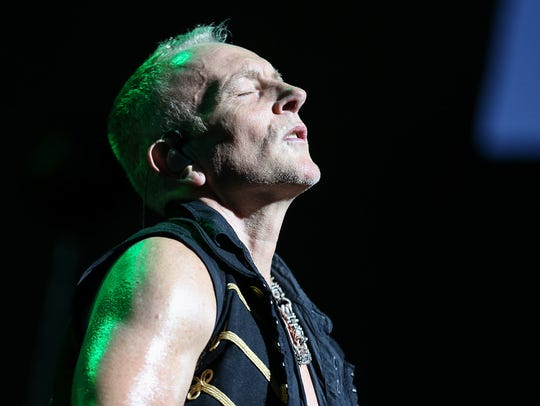 Guitarist Phil Collen of Def Leppard performs at Klipsch Music Center in Noblesville, Ind., Sunday, June 25, 2017.