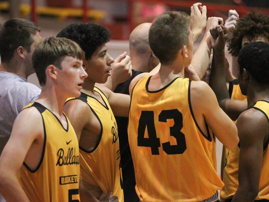 Bettendorf's D.J. Carton huddles with teammates during the Bulldogs' game against Pleasant Valley at Rock Island High School on Saturday, June 24, 2017.