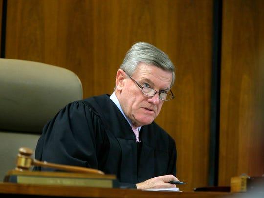 Judge James Blaney arraigns six Lakewood residents