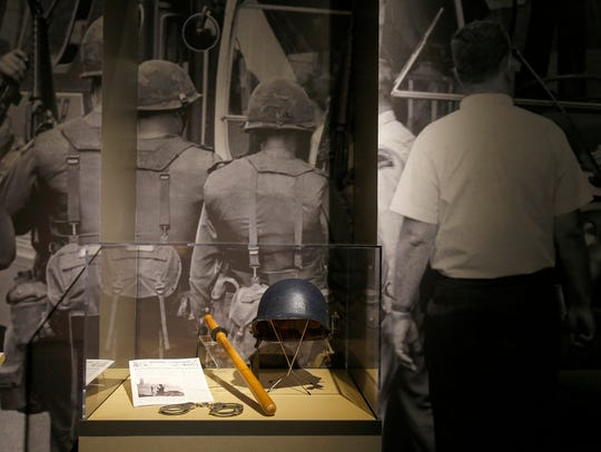 Large photographs and police riot gear from the 1960s