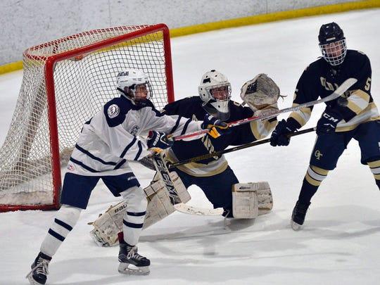 Northern Valley goalie Jack Fitzgerald (center) in action versus Paramus/Hackensack/Lyndhurst during the 2016-17 high school ice hockey season.